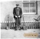 Robbie Wisely holding a peat spad (spade)