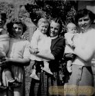 Norma Strachan is the one on the right ,  -  Patricia Ogston is the baby being held by the girl in the middle.