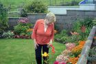 Claire Pudsey with final touches to her garden